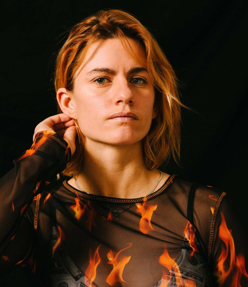Portrait of Florentina Holzinger in a shirt with a flame print